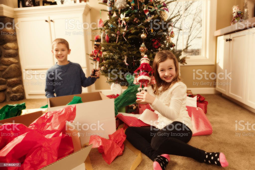 Happy Excited Children Opening Christmas Presents in Front of Tree-2 stock photo