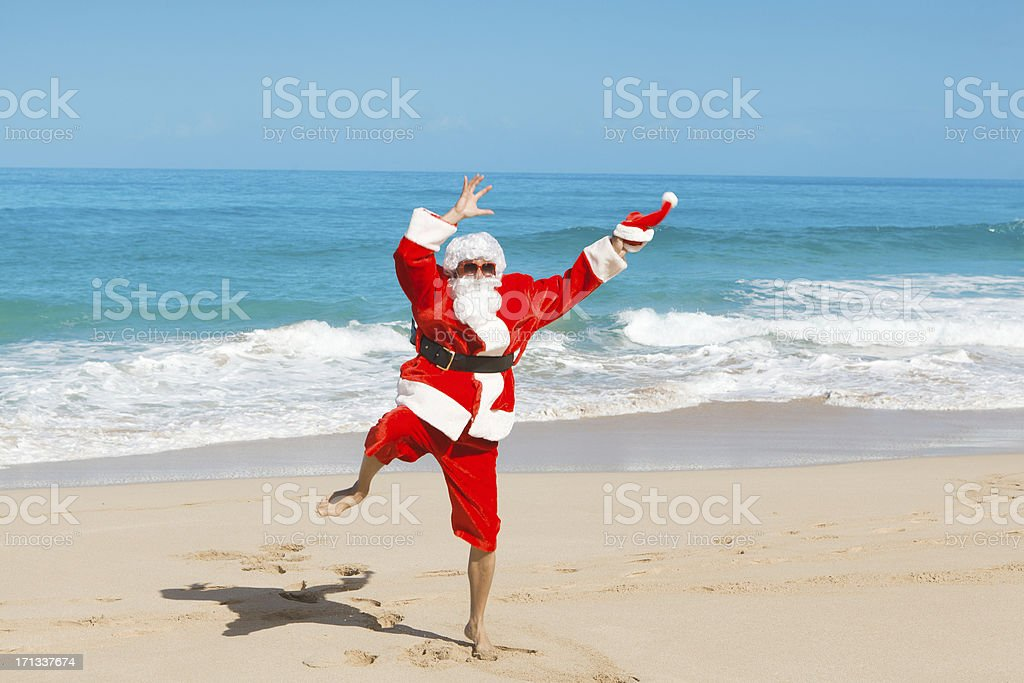 Happy Excited Jumping Santa Claus on  Tropical Beach Vacation-2 royalty-free stock photo