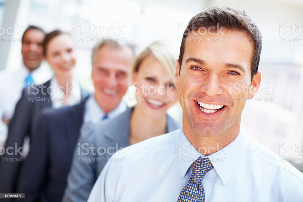 Happy executive with his team in a row royalty-free stock photo