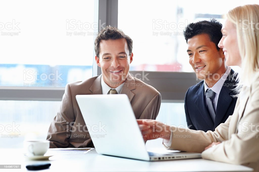 Happy executives working with laptop royalty-free stock photo