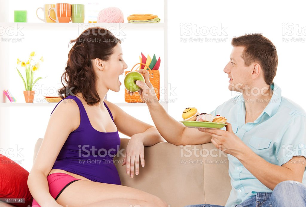 happy expecting parents at home stock photo