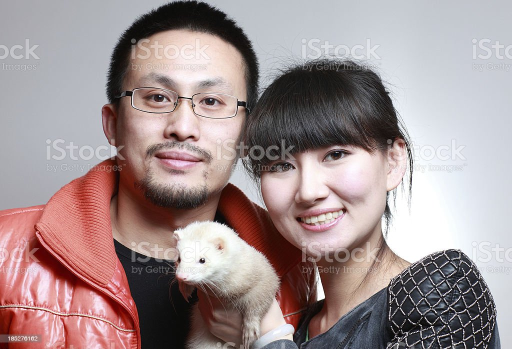 Happy families and their pets royalty-free stock photo