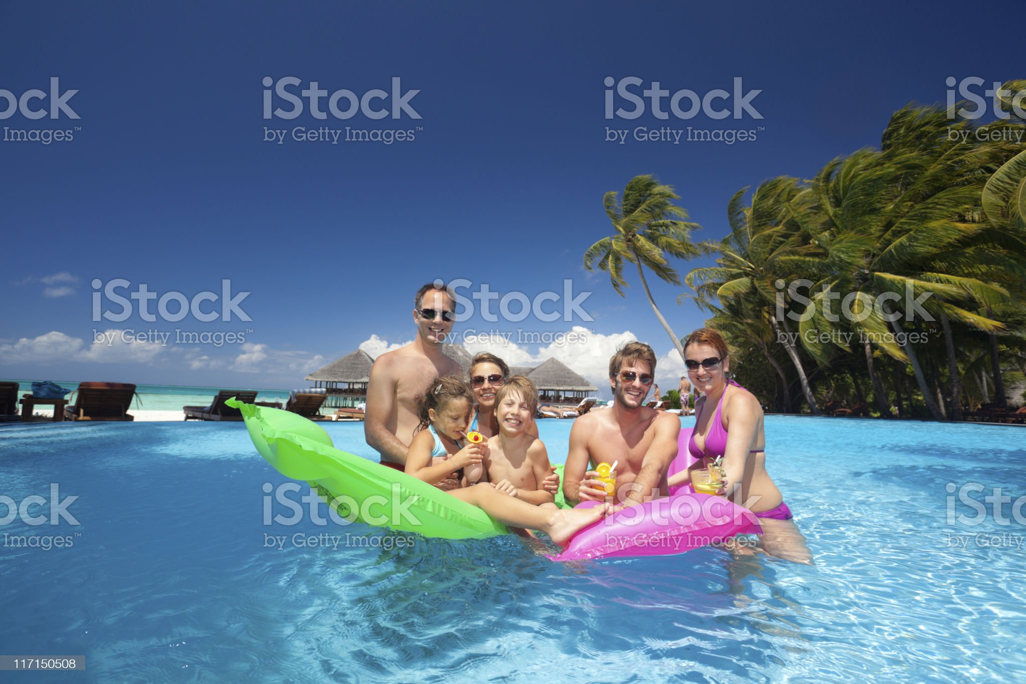 happy families in swimming pool on tropical island royalty-free stock photo