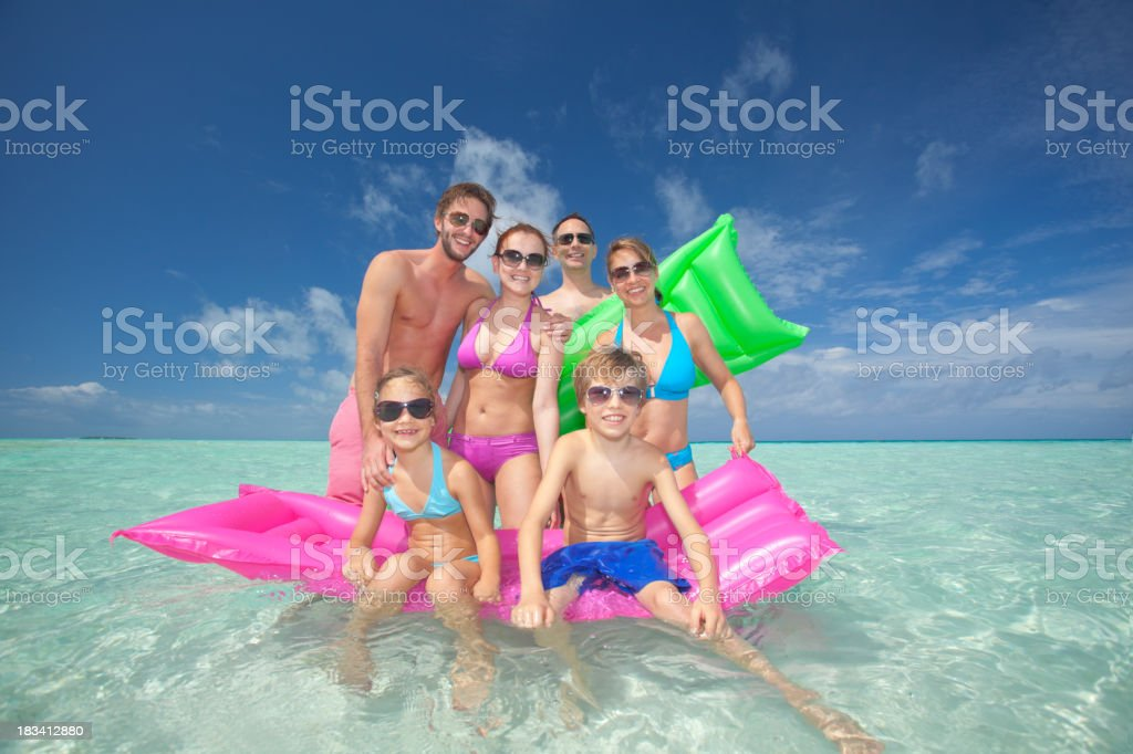 happy families with kids on colorful air mattress royalty-free stock photo