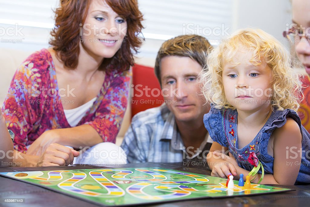 Happy family about to start an exciting board game stock photo