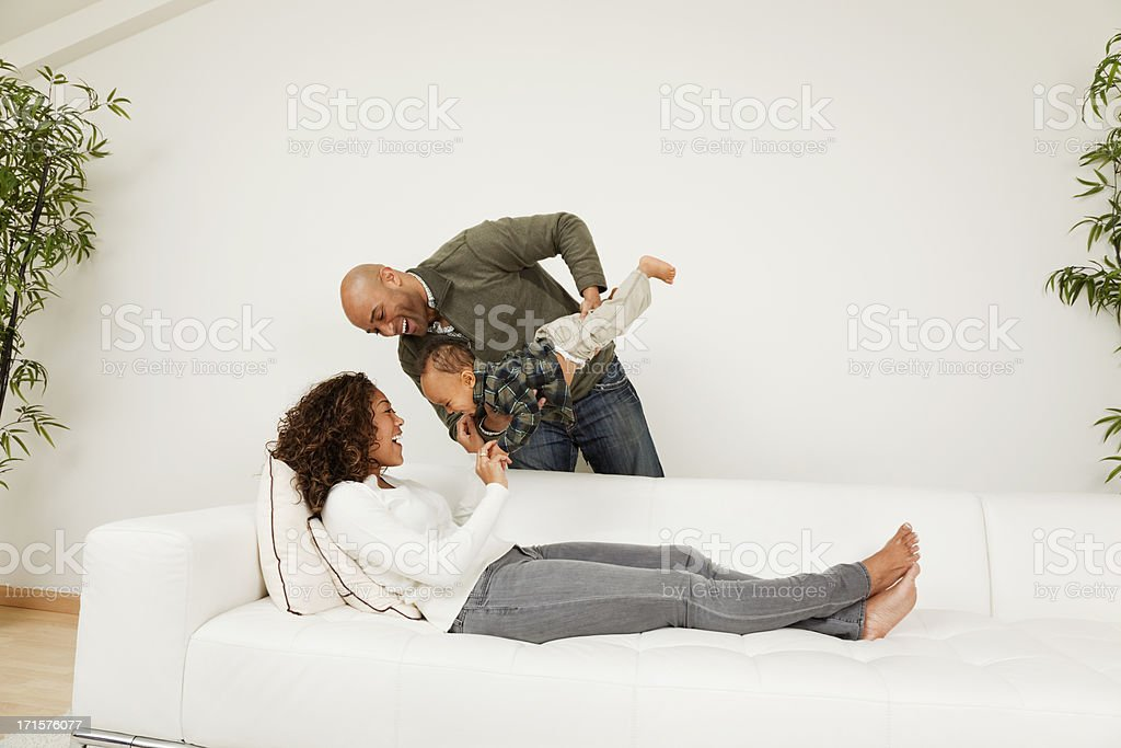 Happy Family African American playing with their baby boy royalty-free stock photo