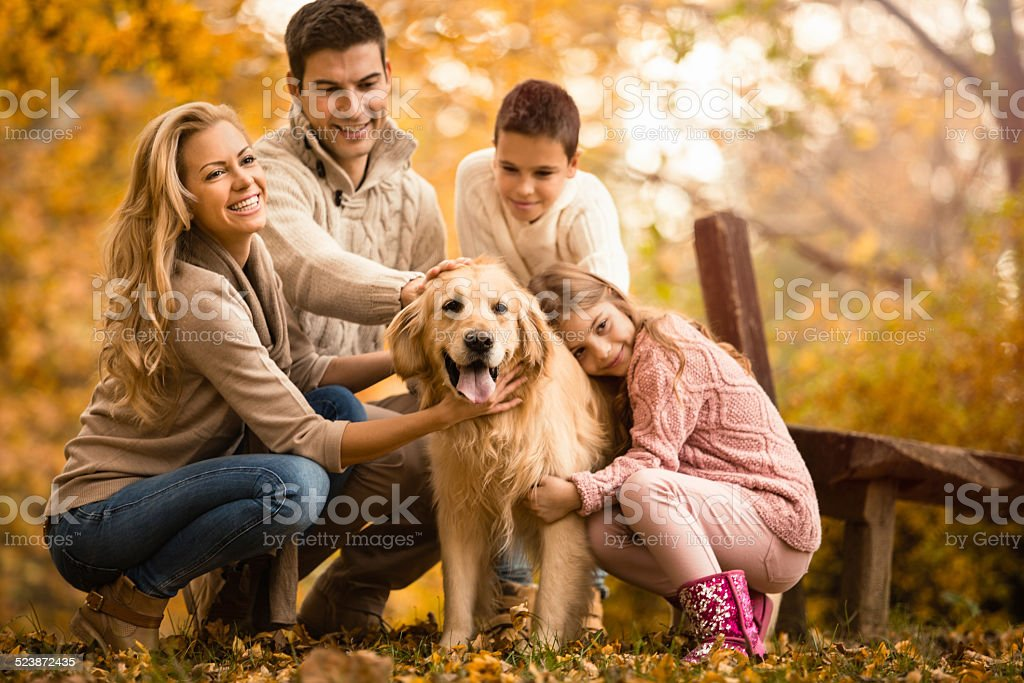 Happy Family And Dog In Autumn stock photo
