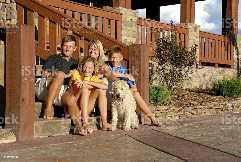 Happy family and pet royalty-free stock photo