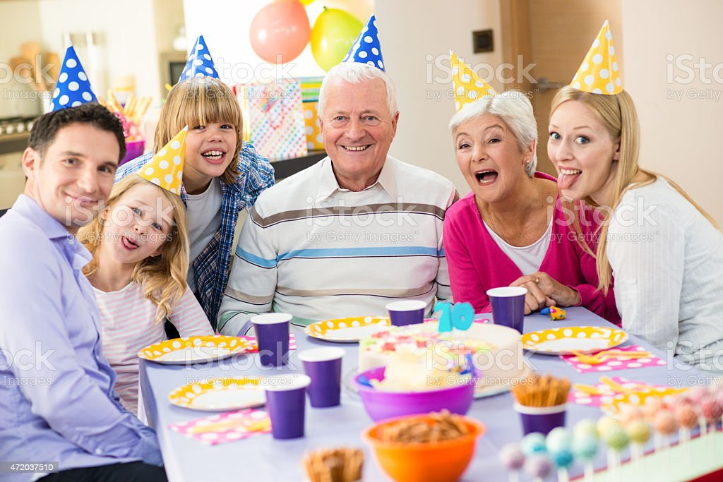 Happy family at a grandfathers birthday party stock photo