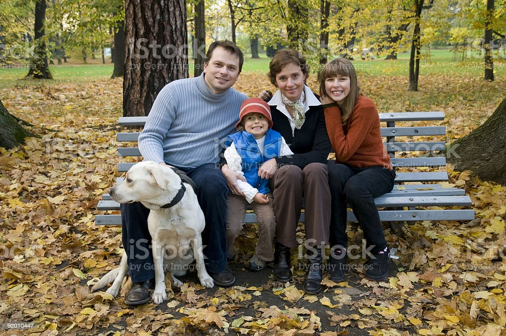 Happy family at autumn time royalty-free stock photo