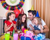 Happy family at birthday party