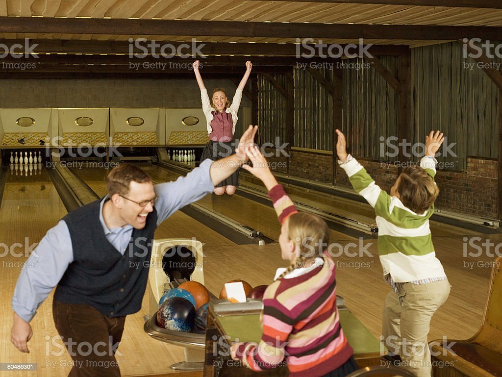 Happy family at bowling alley royalty-free stock photo