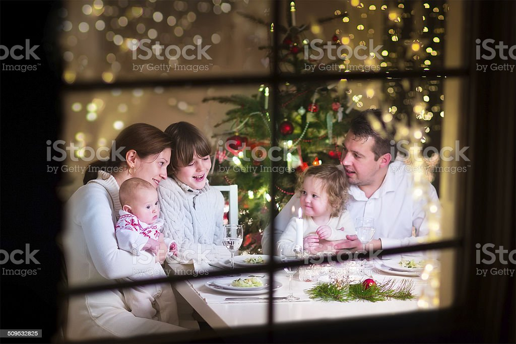 Happy family at Christmas dinner stock photo