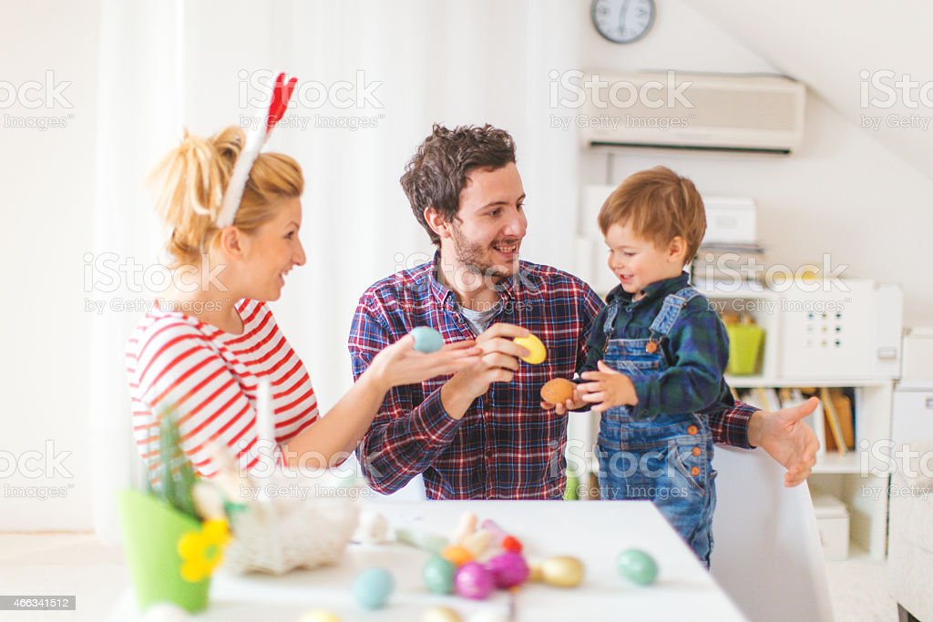 Happy family at Easter day stock photo
