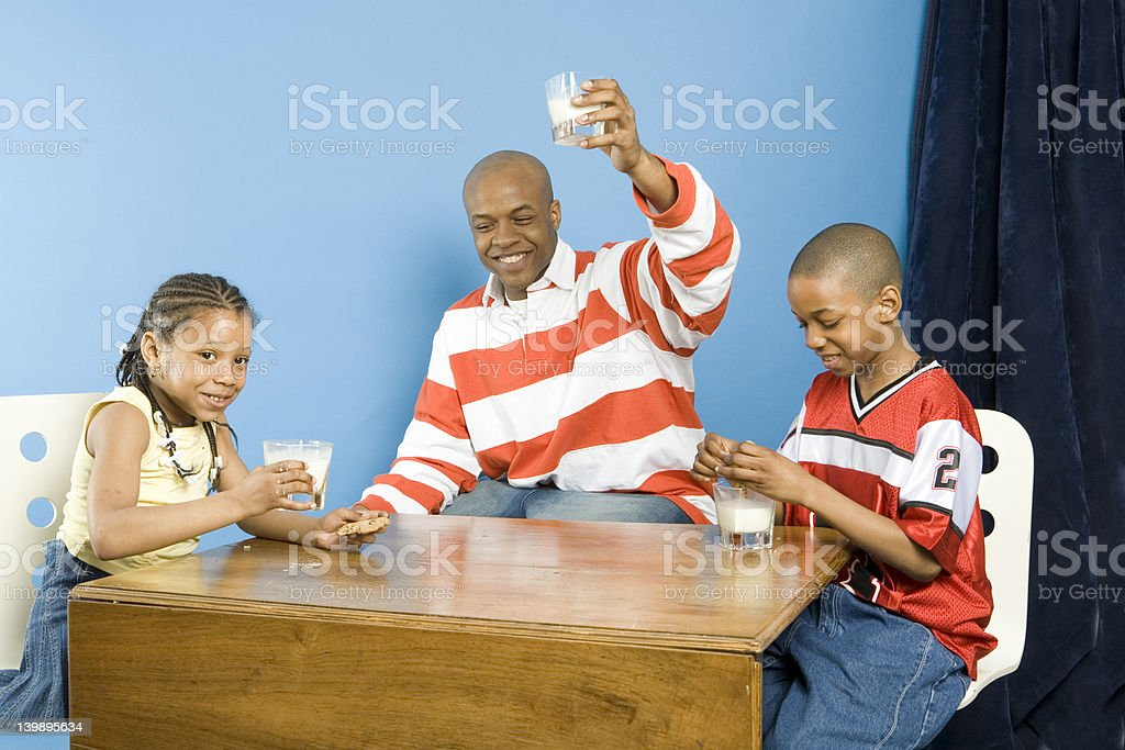 Happy family at snack time stock photo