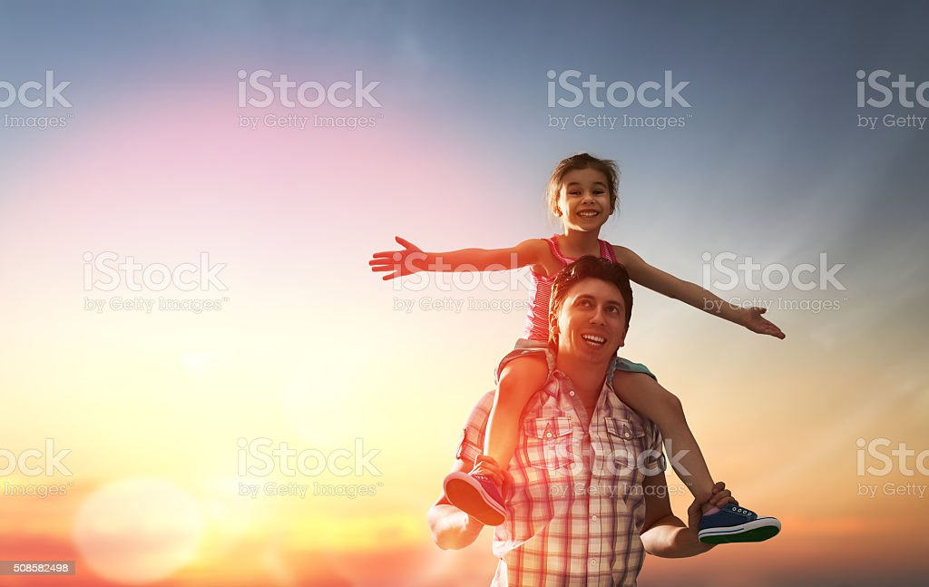 happy family at sunset stock photo