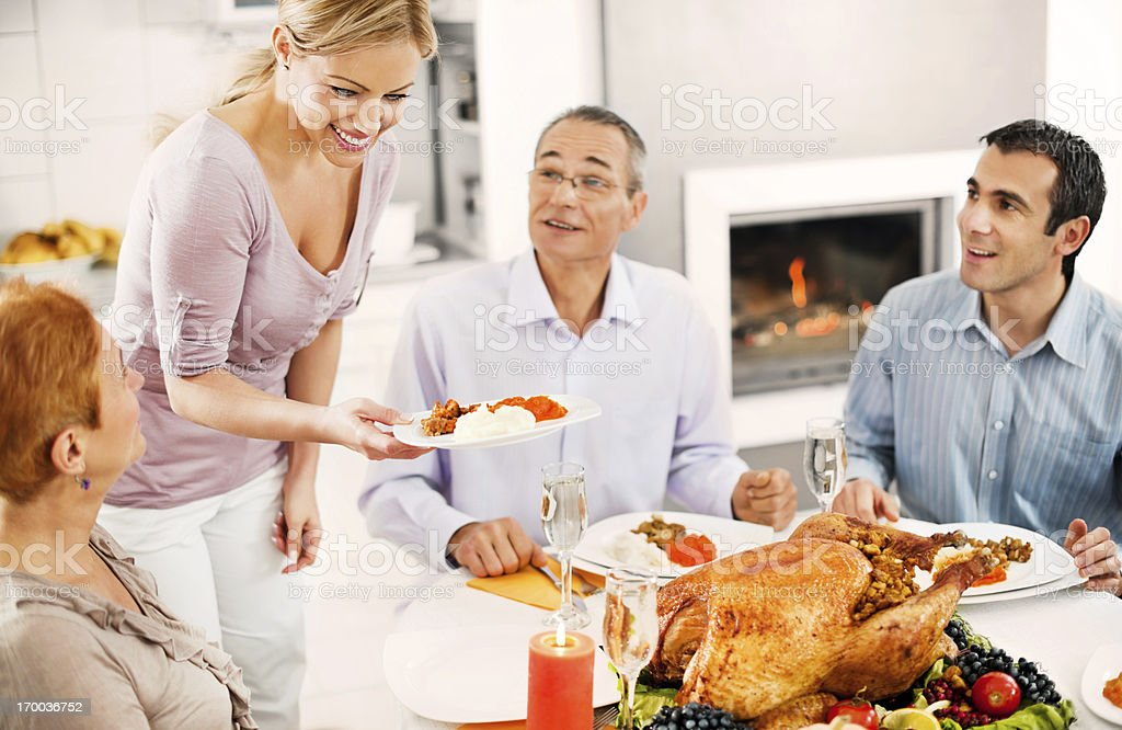 Happy family at Thanksgiving dinner royalty-free stock photo