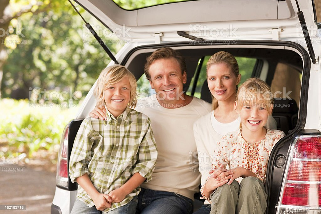 Happy family at the hatchback of a van royalty-free stock photo