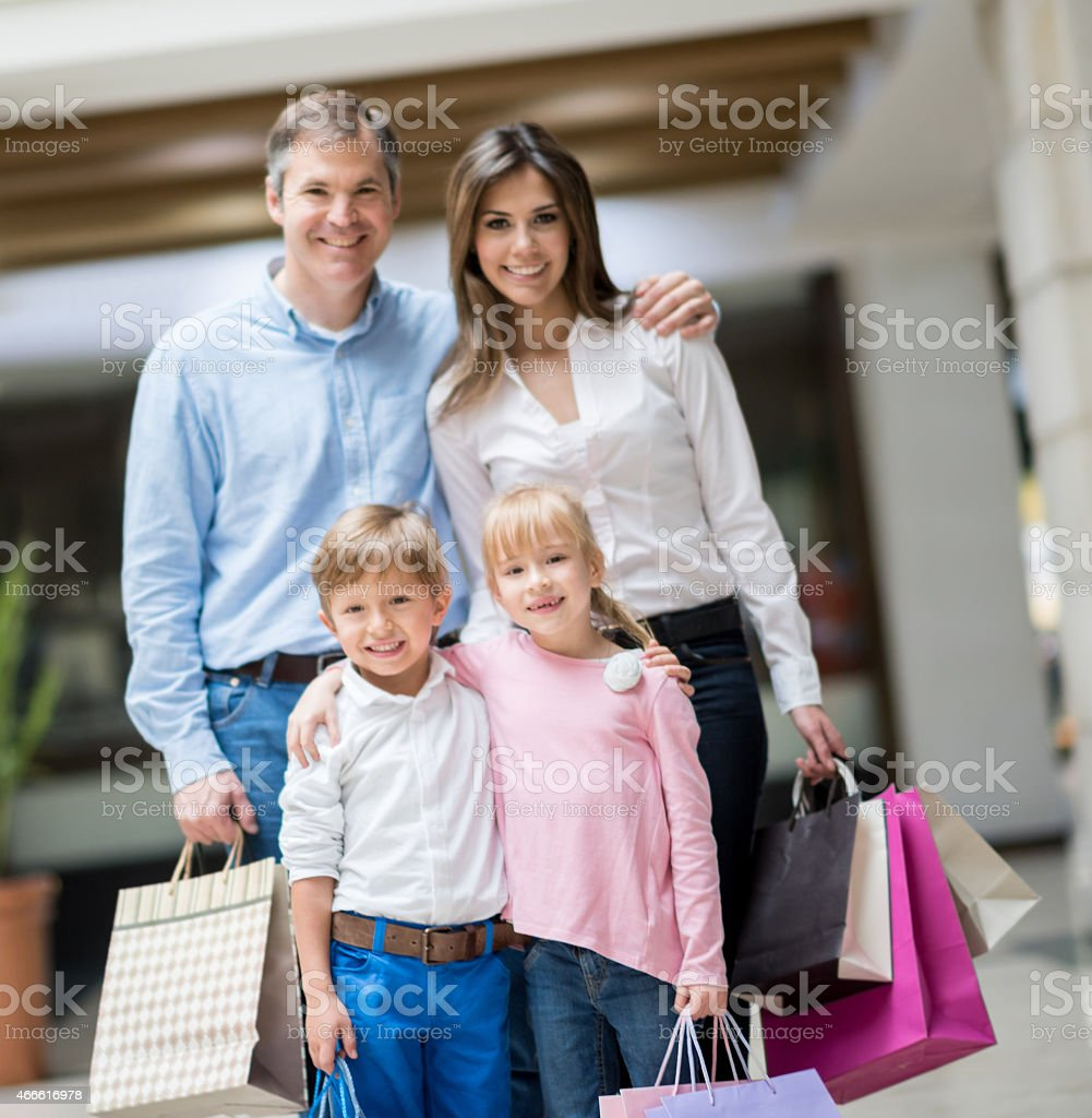 Happy family at the shopping center stock photo
