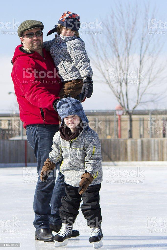 Happy family at the skating rink royalty-free stock photo