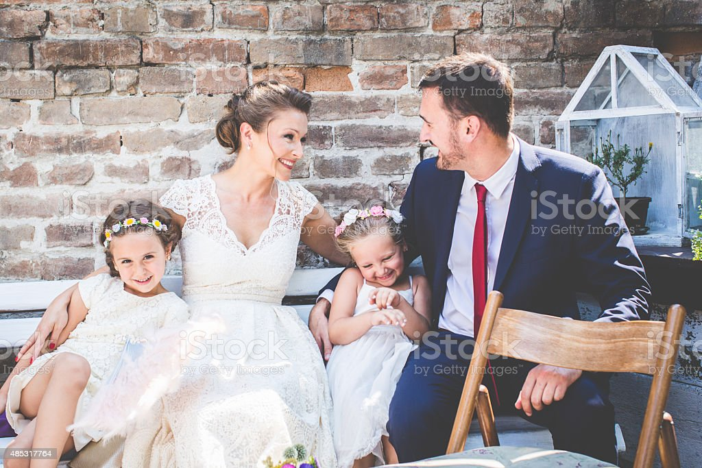Happy family at wedding day stock photo