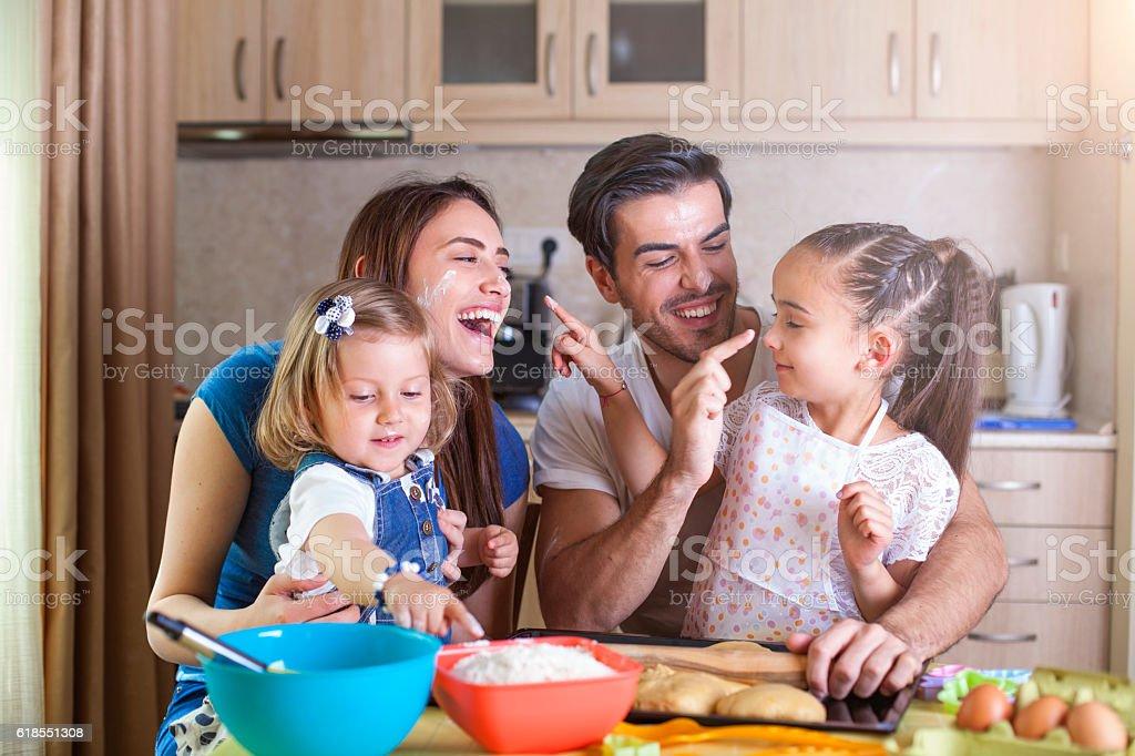 Happy family baking cookies stock photo