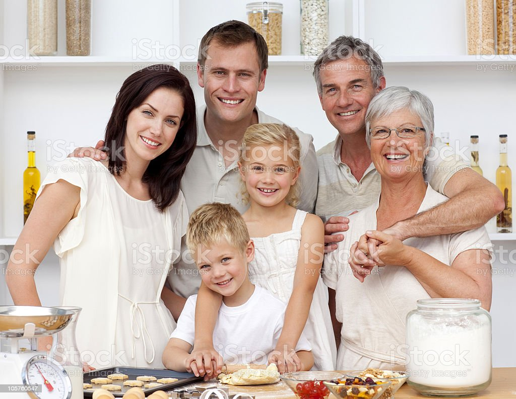Happy family baking in the kitchen royalty-free stock photo