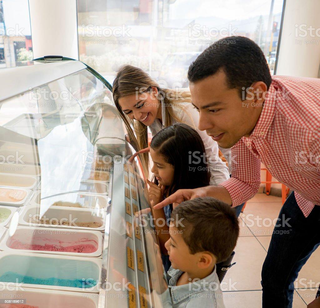 Happy family buying ice creams stock photo