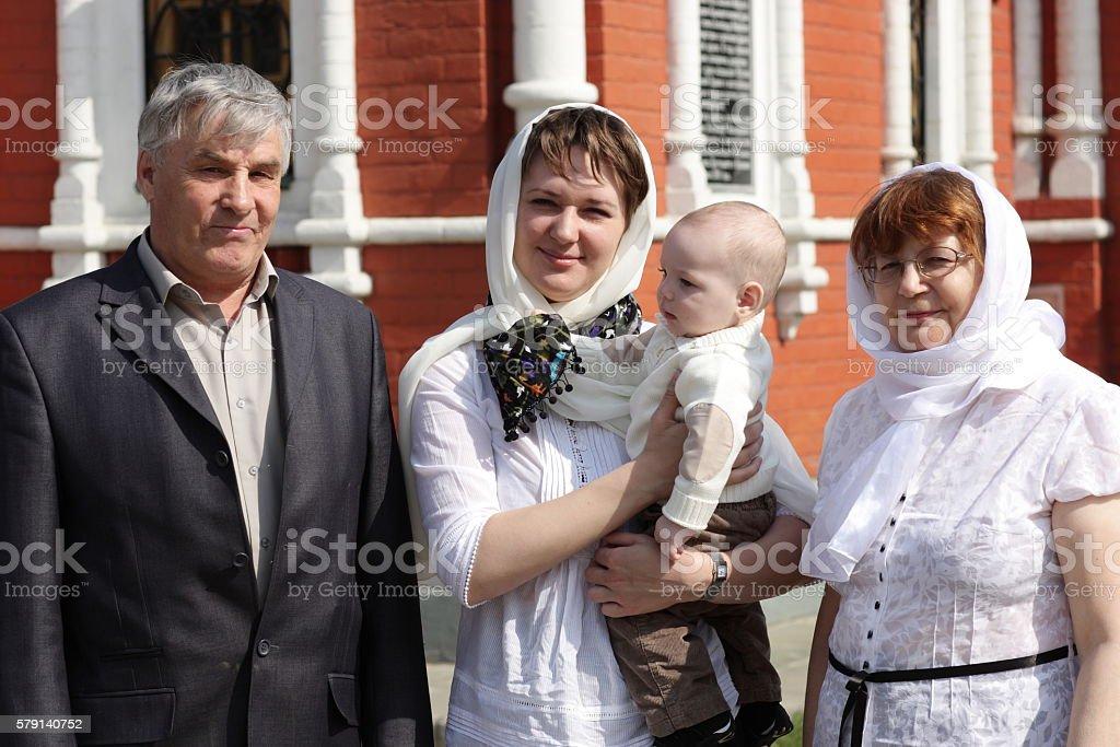 Happy family by church stock photo