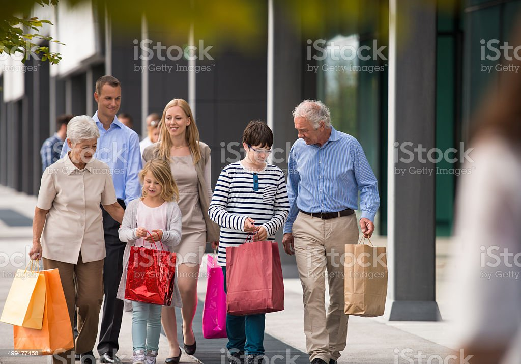Happy Family carrying shopping bags stock photo