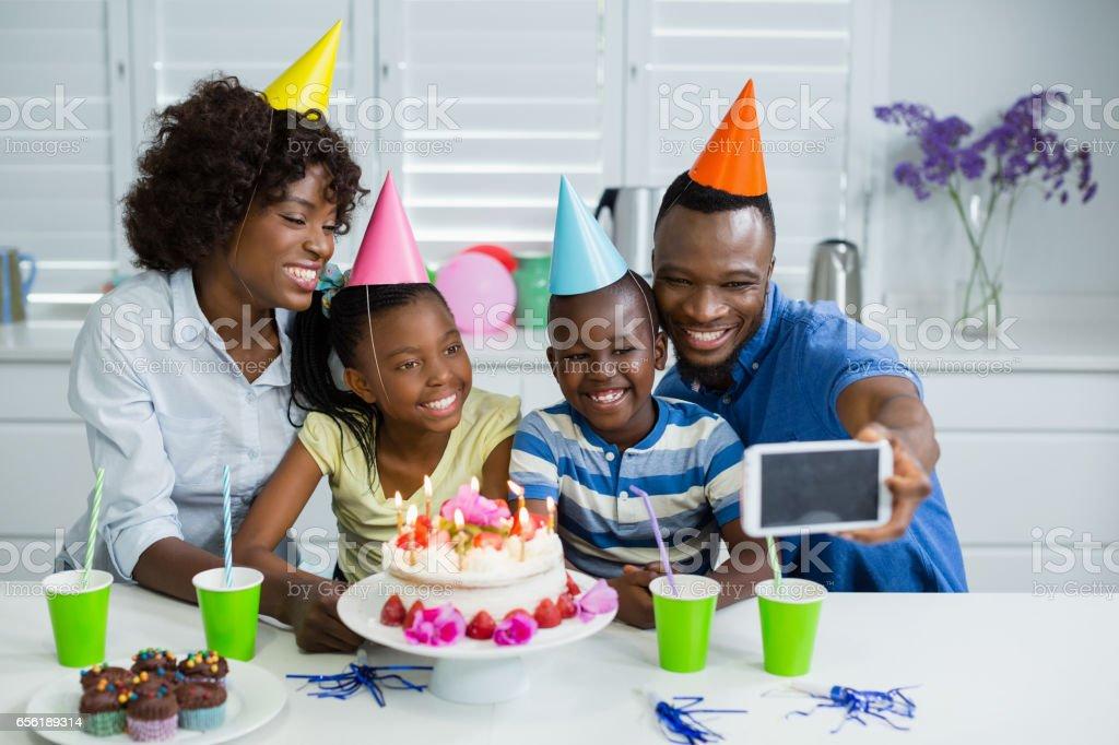 Happy family celebrating birthday party at home stock photo