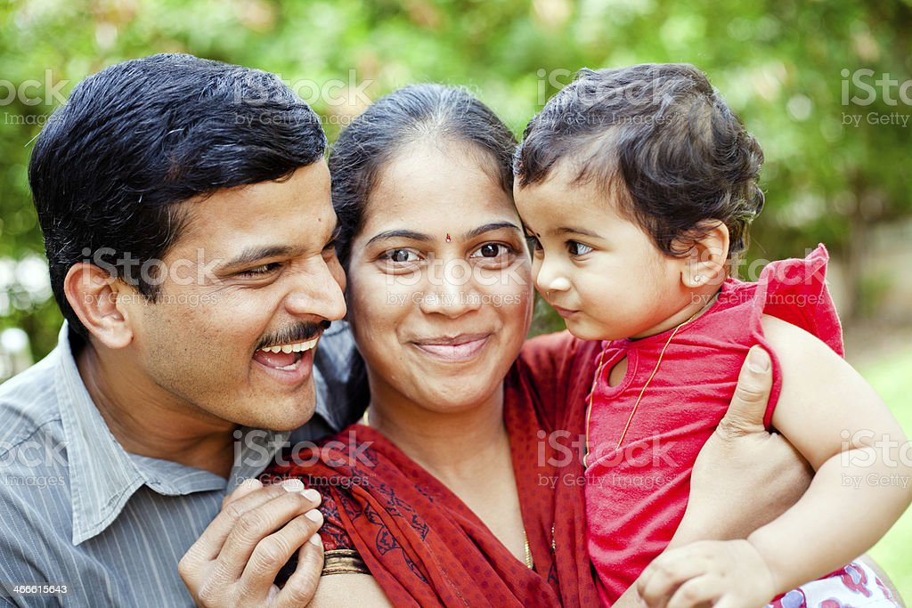 Happy Family Cheerful Young Indian Couple stock photo