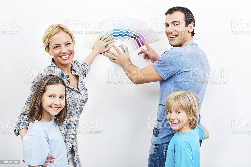 Happy family Choosing Color for wall. royalty-free stock photo