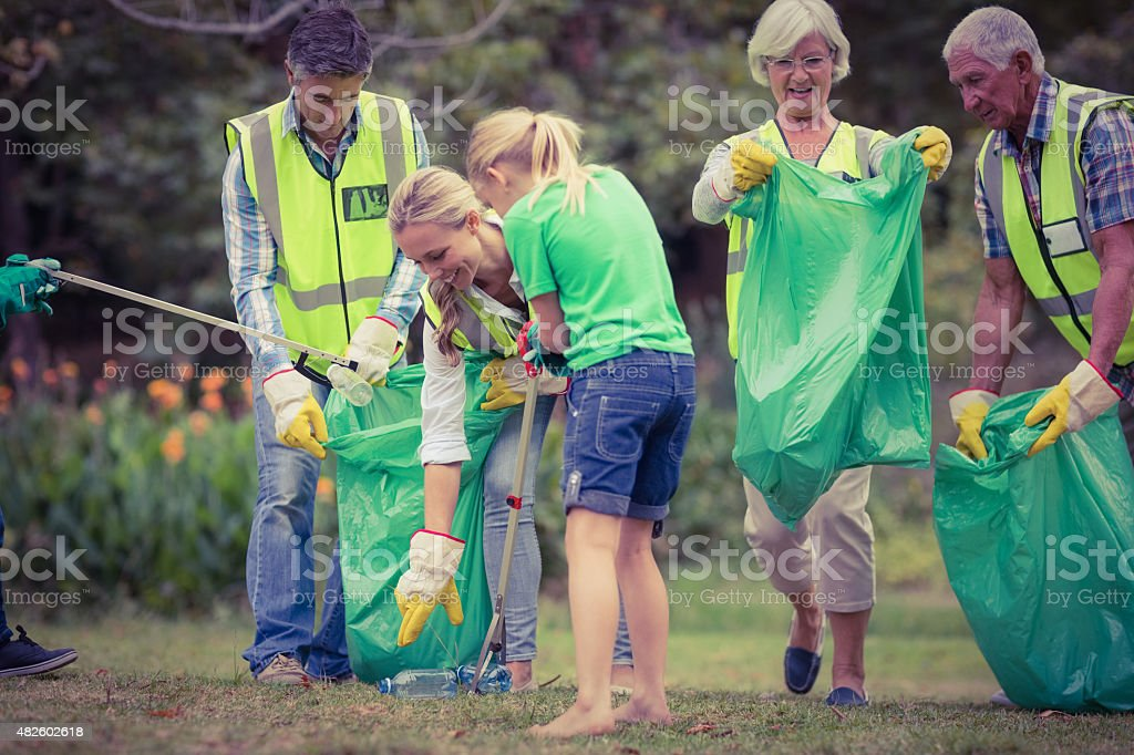 Happy family collecting rubbish stock photo