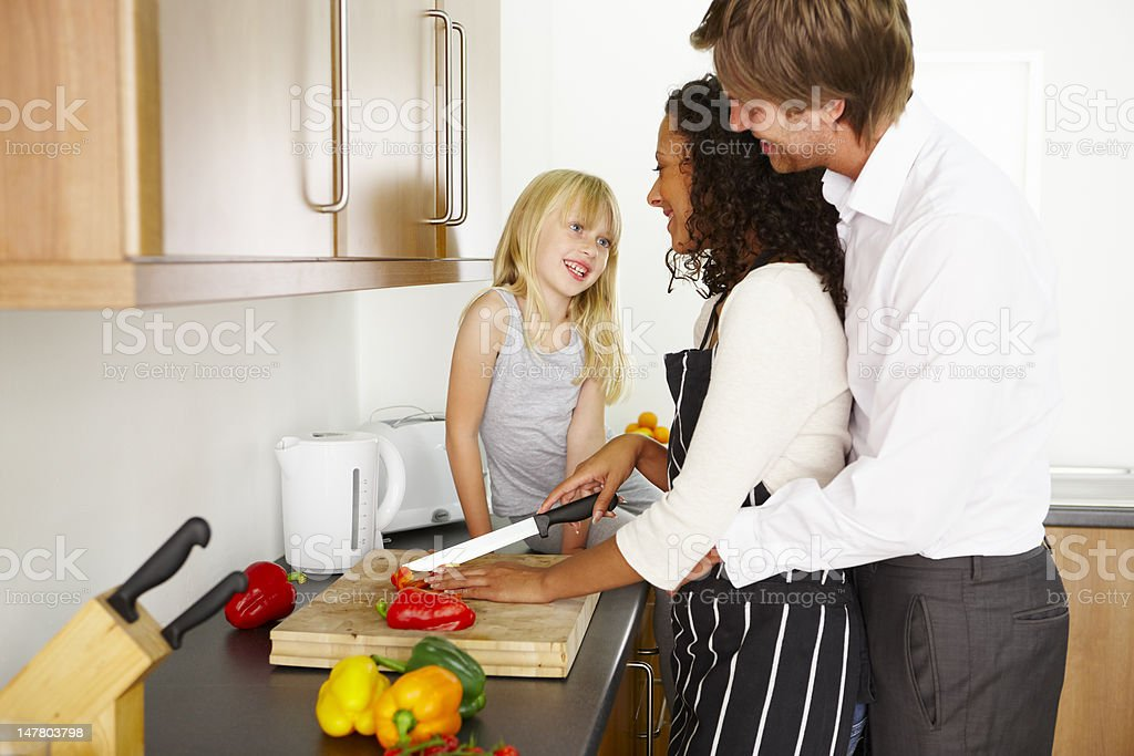 Happy family cooking in the kitchen stock photo