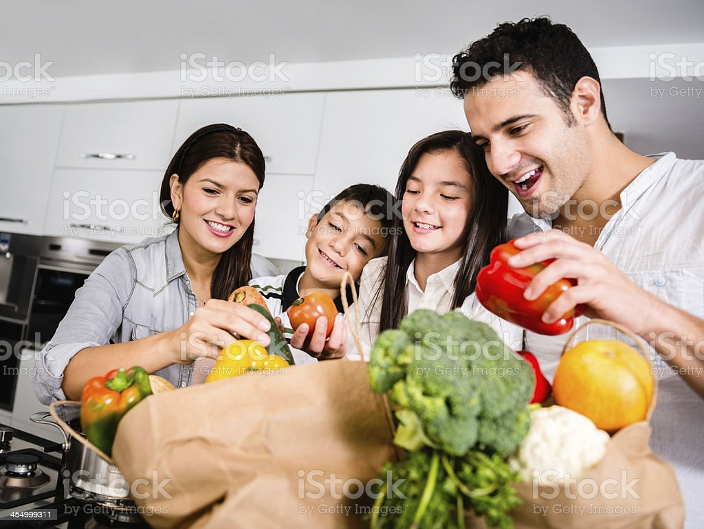 Happy family cooking stock photo