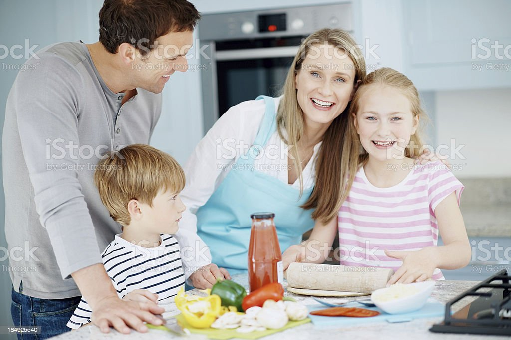 Happy family cooking pizza royalty-free stock photo
