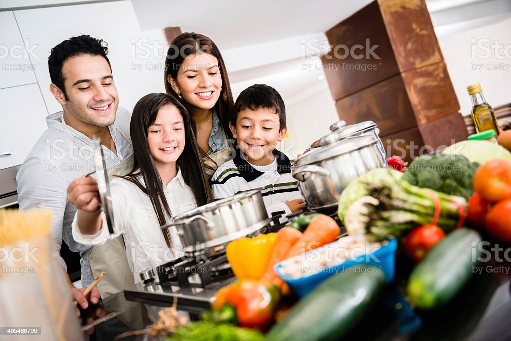Happy family cooking together stock photo