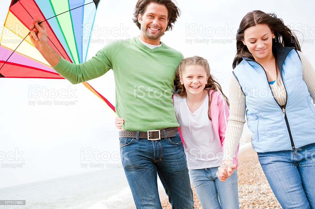 Happy Family Day at the Beach stock photo