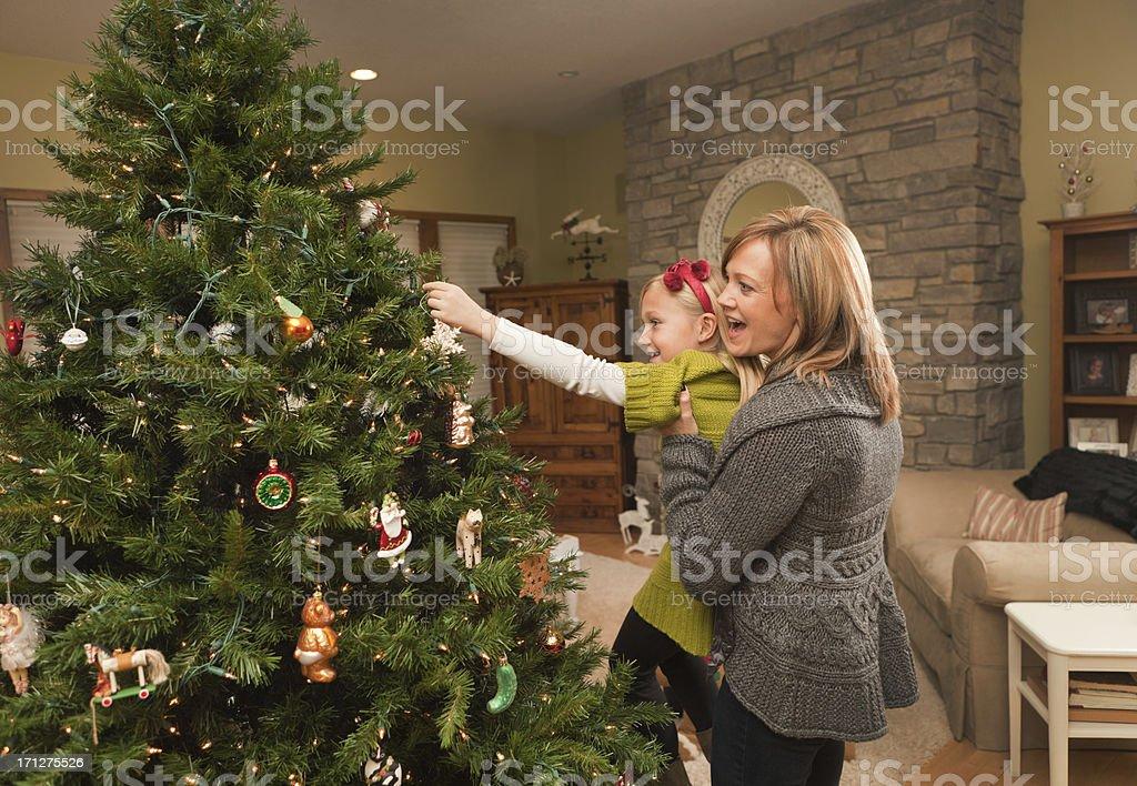 Happy Family Decorating Chriatmas Tree Together Hz royalty-free stock photo