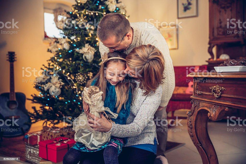 Happy Family decorating the Christmas Tree stock photo