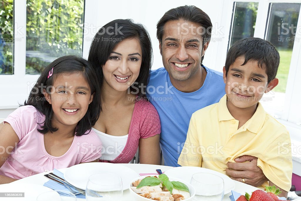 A happy family eating a healthy dinner together royalty-free stock photo