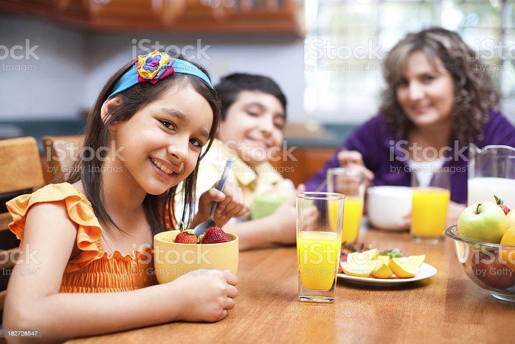 Happy family eating breakfast stock photo