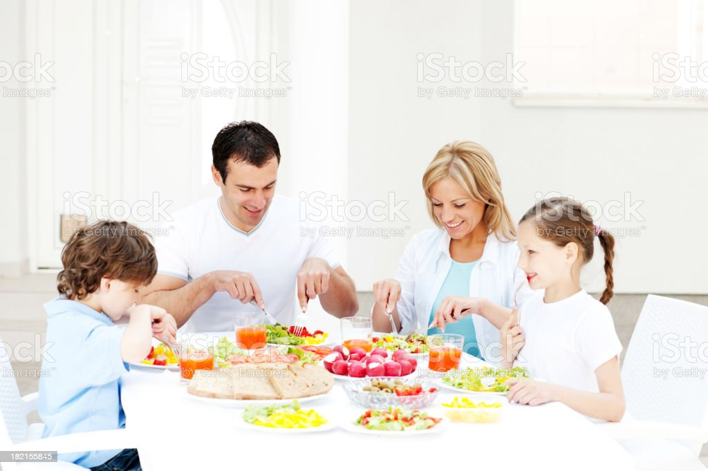 Happy family eating together outdoor. royalty-free stock photo