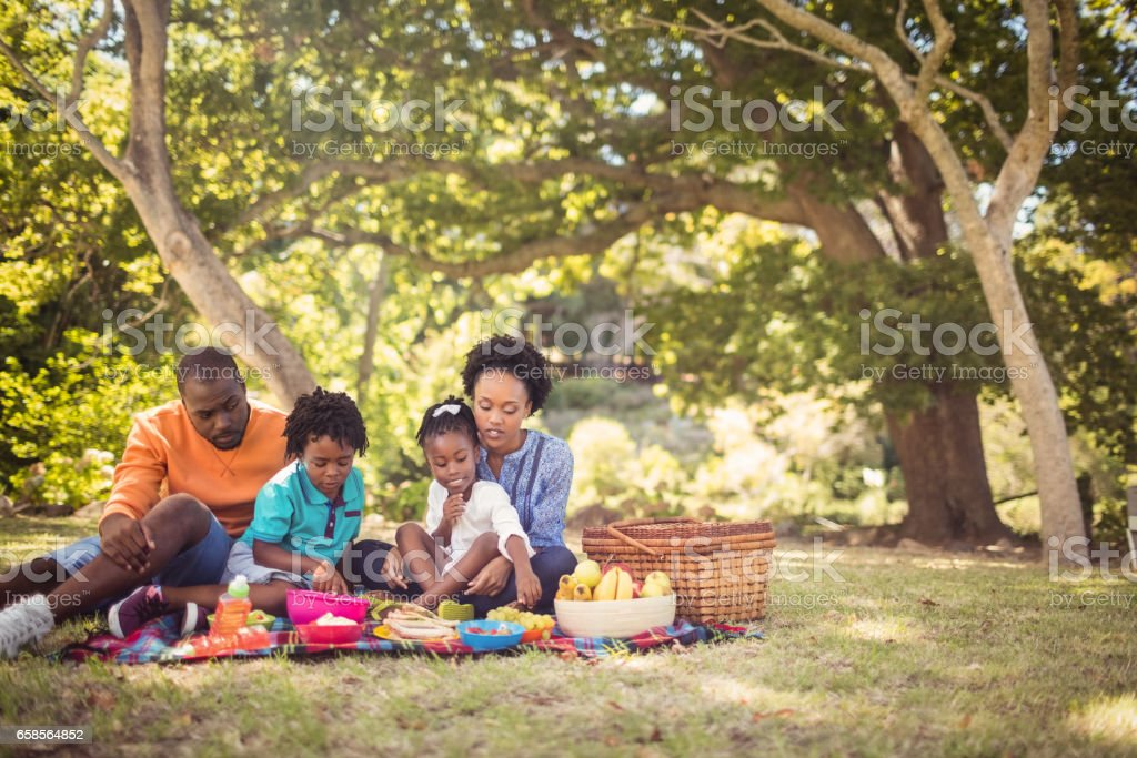 Happy family eating together stock photo