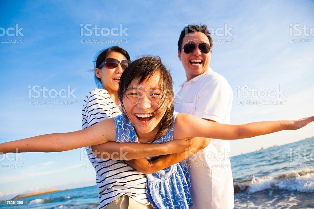 happy family enjoy summer vacation on the beach stock photo