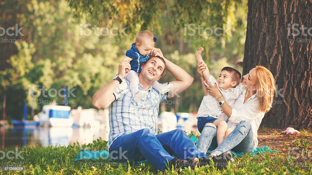 Happy family enjoying a summer day outdoors stock photo
