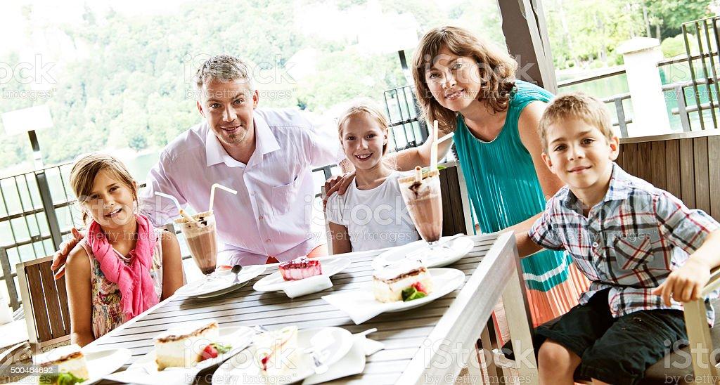 Happy family enjoying ice cream sundae and pastry stock photo
