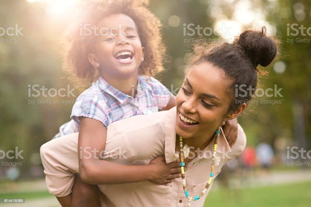 Happy family enjoying in the nature. stock photo