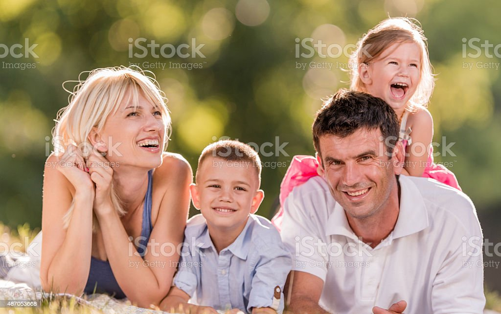 Happy family enjoying together while spending their day outdoors. stock photo